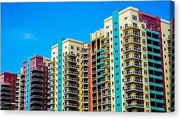 Colored Skyline Canvas Print by Del Martinez