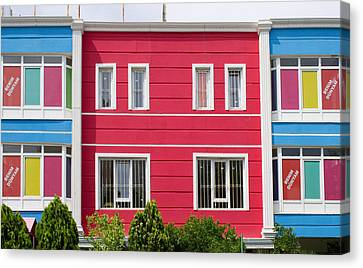 Colorful Building Canvas Print by Tom Gowanlock