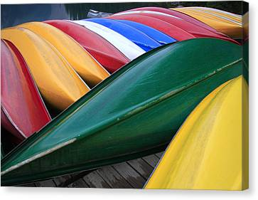 Colorful Canoes Canvas Print by Catherine Alfidi