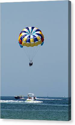 Colorful Parasailing Canvas Print by Kathy Clark