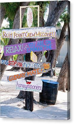 Colorful Signs At Rum Point Grand Cayman Island Canvas Print by George Oze