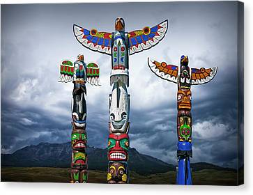 Woodcarving Canvas Print - Colorful Totem Poles In The Northwest by Randall Nyhof