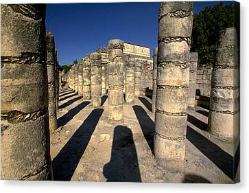 Columns With Shadows At Canvas Print by Raul Touzon