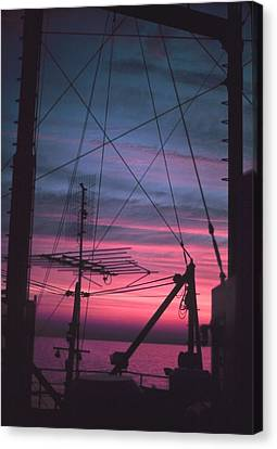 Commercial Riggings With Sunset Canvas Print by PhotographyAssociates