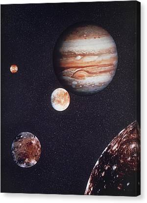 Composite Image Of Jupiter & Four Of Its Moons Canvas Print by Nasa