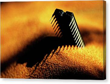 Computer Chip Half-buried In Sand Canvas Print by Sami Sarkis