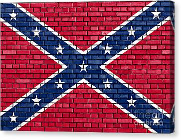 Confederate Flag Painted On Brick Wall Canvas Print by Dan Radi