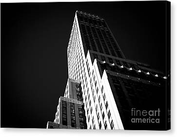 Conflict In The City Canvas Print by John Rizzuto