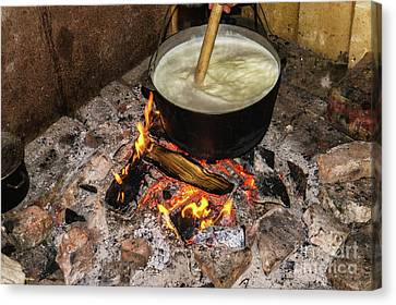 Cooking Fires In A Black Iron Pot Canvas Print by Oleksandr Masnyi