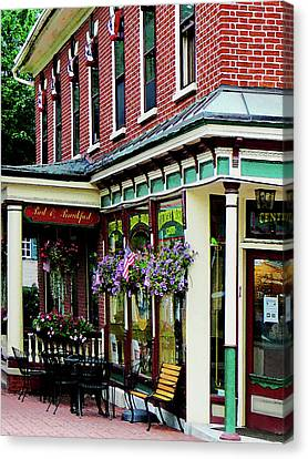 Corner Restaurant With Hanging Plants Canvas Print