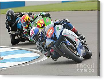 Cornering Motorcycle Racers Canvas Print by Peter Hatter