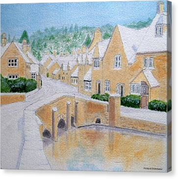 Cotswold Winter - Castle Combe Canvas Print by Peter Farrow