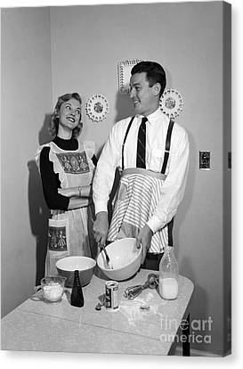 Couple Baking, C.1950s Canvas Print by Debrocke/ClassicStock