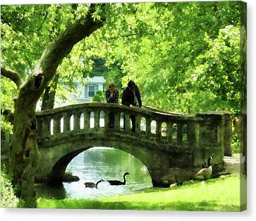 Couple On Bridge In Park Canvas Print by Susan Savad