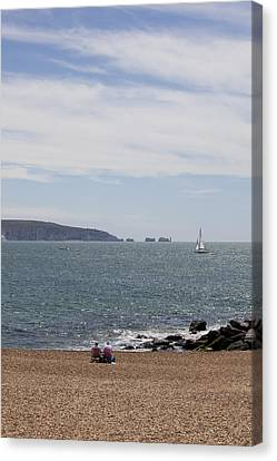 Couple Relaxing  Enjoying The View Canvas Print by Gillian Dernie