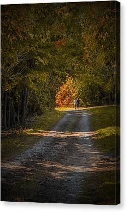 Couple Walking On A Dirt Road Through A Tree Canopy During Autumn Canvas Print by Randall Nyhof