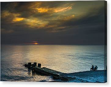 Canvas Print featuring the photograph Couple Watching Sunset by John Williams