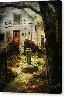 Canvas Print featuring the photograph Courtyard And Fountain by John Rivera