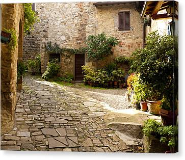 Courtyard In Montefioralle Canvas Print by Rae Tucker