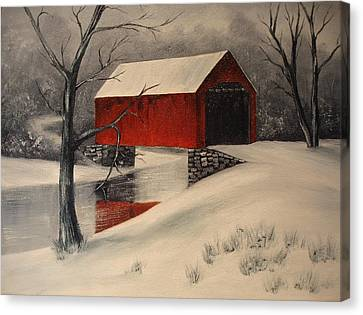 Covered Bridge In The Snow Canvas Print by Rosie Phillips