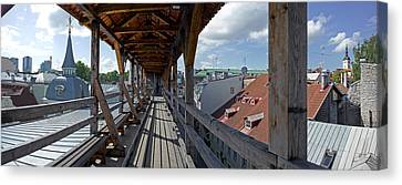 Covered Bridge With St Olafs Church Canvas Print by Panoramic Images