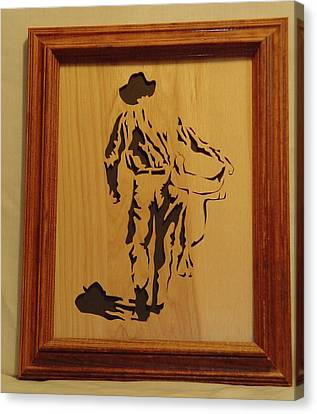Cowboy And Saddle Canvas Print by Russell Ellingsworth
