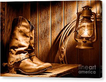 Cowboy Boots In Old Barn - Sepia Canvas Print