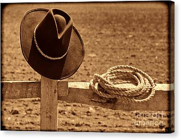 Cowboy Hat And Rope On A Fence Canvas Print by American West Legend By Olivier Le Queinec