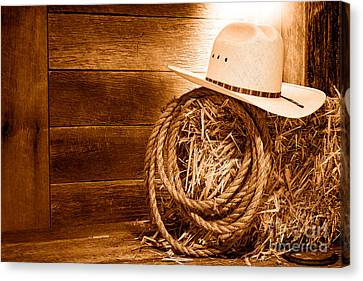 Cowboy Hat On Hay Bale - Sepia Canvas Print by Olivier Le Queinec