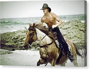 Cowboy Riding Horse On The Beach Canvas Print