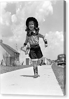 Tomboy Canvas Print - Cowgirl Running Down Sidewalk, C.1950s by H. Armstrong Roberts/ClassicStock