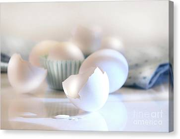 Cracked Egg Shell On The Counter Canvas Print by Sandra Cunningham