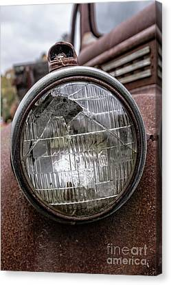Cracked Headlight On An Old Truck Canvas Print by Edward Fielding