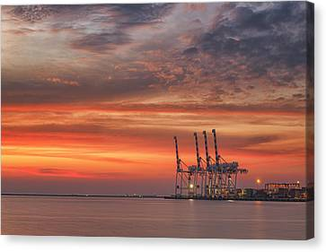 cranes and industrial cargo ships in Varna port at sunset Canvas Print