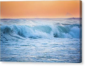 Crashing At Sunset Canvas Print by Parker Cunningham