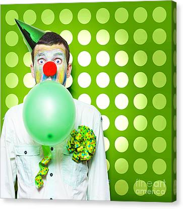 Youthful Canvas Print - Crazy Party Clown Inflating Green Party Balloon by Jorgo Photography - Wall Art Gallery