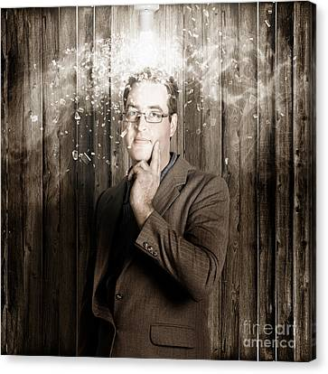 Creative Business Man With Bright Light Bulb Idea Canvas Print by Jorgo Photography - Wall Art Gallery
