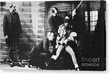 Law Enforcement Canvas Print - Criminal Being Held Down For Mug Shot by Photo Researchers