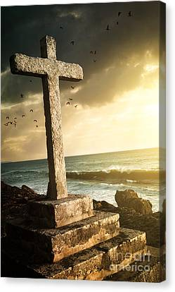Cross In A Cliff Canvas Print by Carlos Caetano