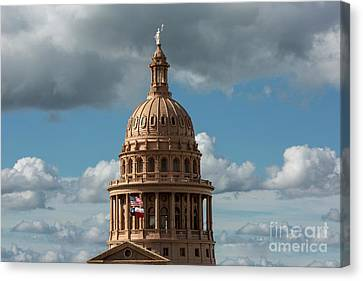Crowning The Dome Of The Texas State Capitol Stands The Goddess  Canvas Print by Herronstock Prints