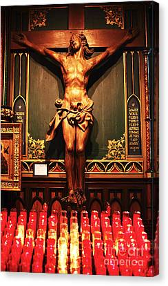 Crucifix At Notre Dame Canvas Print by John Rizzuto