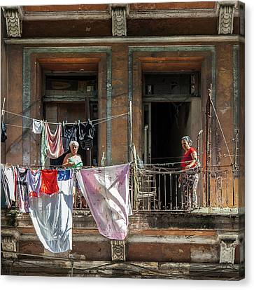 Canvas Print featuring the photograph Cuban Women Hanging Laundry In Havana Cuba by Charles Harden