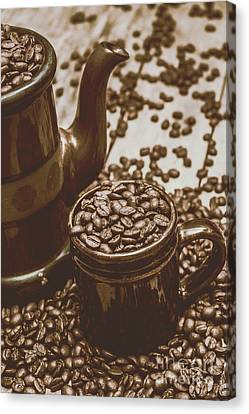 Cup And Teapot Filled With Roasted Coffee Beans Canvas Print