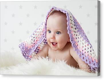 Cute Baby Laughing While Lying Under A Woollen Blanket. Canvas Print