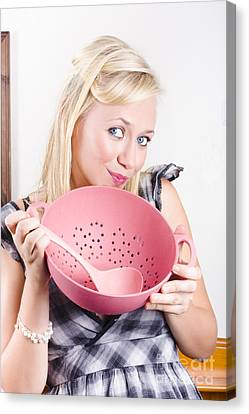 Cute Cook Holding Pink Sieve When Cooking At Home Canvas Print