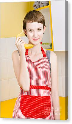 Youthful Canvas Print - Cute Girl Talking On Fruit Phone In Kitchen by Jorgo Photography - Wall Art Gallery