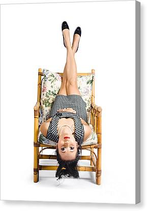 Cute Young Woman Sitting Upside Down On Chair Canvas Print