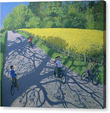 Cyclists And Yellow Field Canvas Print by Andrew Macara