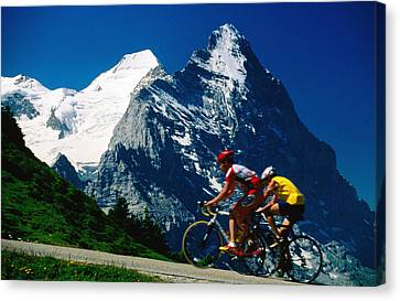 Cyclists In Front Of Eiger And Snow-covered Monch, Grosse Scheidegg, Grindelwald, Bern, Switzerland, Europe Canvas Print by David Tomlinson