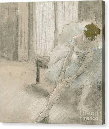 Dancer Seated, Readjusting Her Stocking Canvas Print by Edgar Degas
